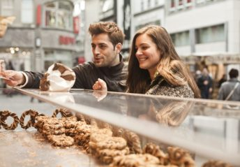 man and woman buying sweets