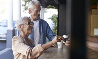 elderly couple getting coffee